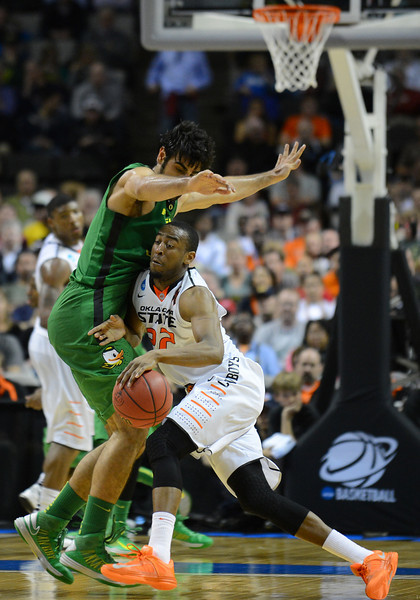 March 21, 2013: Oklahoma State Cowboys guard Markel Brown (22) tries to drive past Oregon Ducks forward Arsalan Kazemi (14) during a game between the Oregon Ducks and the Oklahoma State Cowboys in the second round of the NCAA Division I Men's Basketball Championship at HP Pavilion in San Jose, California.
