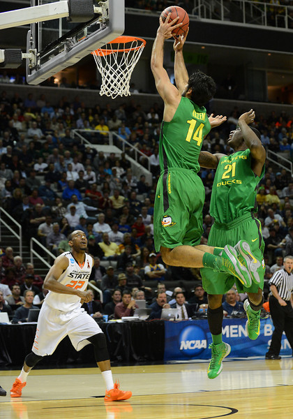 March 21, 2013: Oregon Ducks forward Arsalan Kazemi (14) grabs an offensive rebound during a game between the Oregon Ducks and the Oklahoma State Cowboys in the second round of the NCAA Division I Men's Basketball Championship at HP Pavilion in San Jose, California.