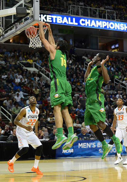 March 21, 2013: Oregon Ducks forward Arsalan Kazemi (14) slams home an offensive rebound during a game between the Oregon Ducks and the Oklahoma State Cowboys in the second round of the NCAA Division I Men's Basketball Championship at HP Pavilion in San Jose, California.