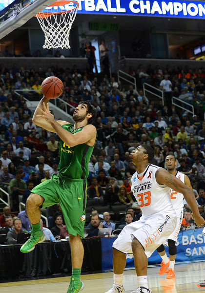 March 21, 2013: Oregon Ducks forward Arsalan Kazemi (14) drives for a layup during a game between the Oregon Ducks and the Oklahoma State Cowboys in the second round of the NCAA Division I Men's Basketball Championship at HP Pavilion in San Jose, California.