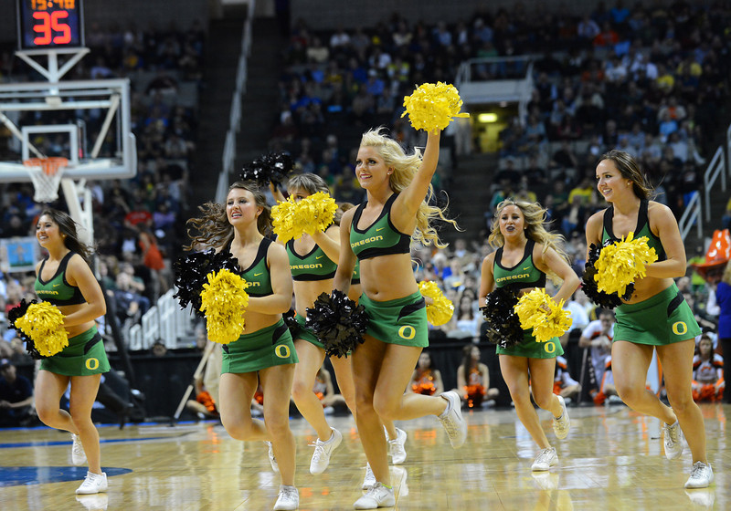 March 21, 2013: The Oregon Ducks cheerleaders perform in a timeout during a game between the Oregon Ducks and the Oklahoma State Cowboys in the second round of the NCAA Division I Men's Basketball Championship at HP Pavilion in San Jose, California.