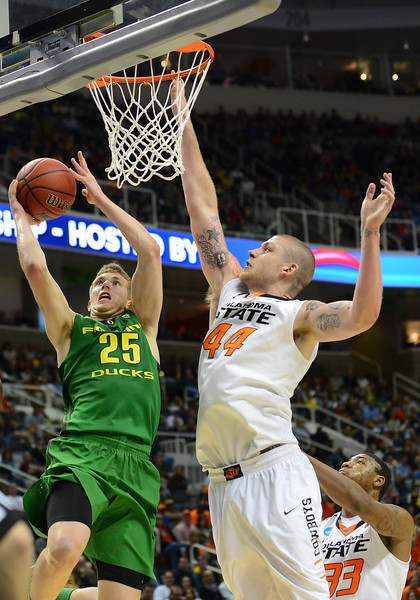 March 21, 2013: Oregon Ducks forward E.J. Singler (25) drives in for a layup during a game between the Oregon Ducks and the Oklahoma State Cowboys in the second round of the NCAA Division I Men's Basketball Championship at HP Pavilion in San Jose, California.