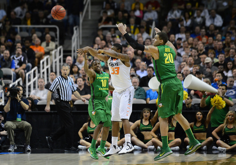 March 21, 2013: Oklahoma State Cowboys guard Marcus Smart (33) passes out of a trap by Oregon Ducks guard Johnathan Loyd (10) and Oregon Ducks center Waverly Austin (20) during a game between the Oregon Ducks and the Oklahoma State Cowboys in the second round of the NCAA Division I Men's Basketball Championship at HP Pavilion in San Jose, California.