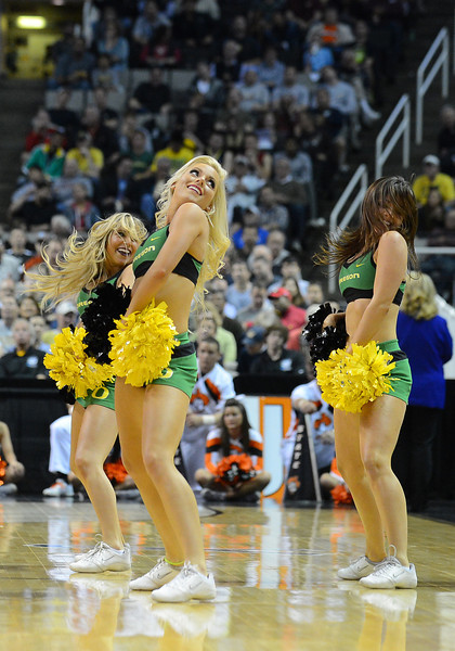 March 21, 2013: Oregon Ducks cheerleaders perform in a timeout during a game between the Oregon Ducks and the Oklahoma State Cowboys in the second round of the NCAA Division I Men's Basketball Championship at HP Pavilion in San Jose, California.