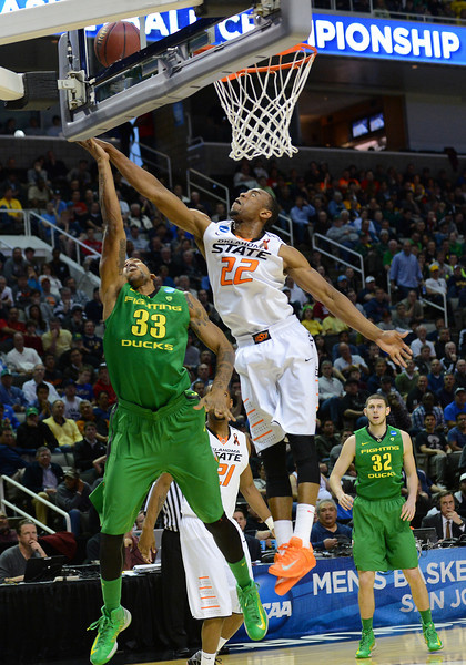 March 21, 2013: Oklahoma State Cowboys guard Markel Brown (22) blocks a layup attempt by Oregon Ducks forward Carlos Emory (33) during a game between the Oregon Ducks and the Oklahoma State Cowboys in the second round of the NCAA Division I Men's Basketball Championship at HP Pavilion in San Jose, California.
