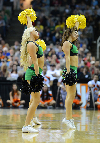 March 21, 2013: A pair of Oregon Ducks cheerleaders perform in a timeout during a game between the Oregon Ducks and the Oklahoma State Cowboys in the second round of the NCAA Division I Men's Basketball Championship at HP Pavilion in San Jose, California.