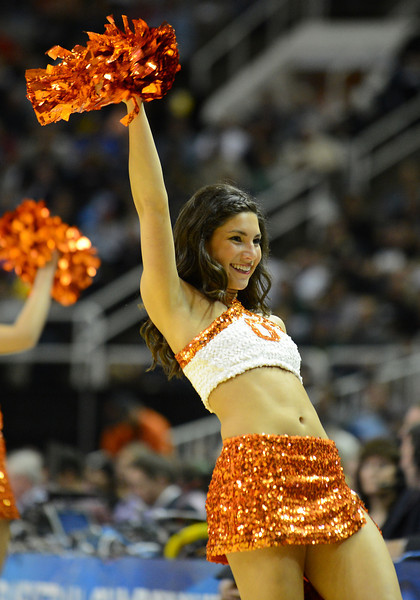 March 21, 2013: An Oklahoma State Cowboys cheerleader performs in a timeout during a game between the Oregon Ducks and the Oklahoma State Cowboys in the second round of the NCAA Division I Men's Basketball Championship at HP Pavilion in San Jose, California.