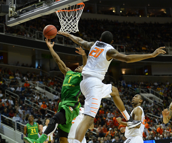 March 21, 2013: Oklahoma State Cowboys forward Michael Cobbins (20) tries to block a layup attempt from Oregon Ducks guard Dominic Artis (1) during a game between the Oregon Ducks and the Oklahoma State Cowboys in the second round of the NCAA Division I Men's Basketball Championship at HP Pavilion in San Jose, California.