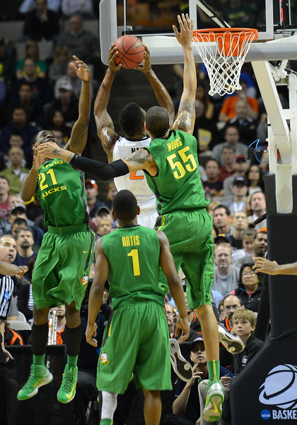 March 21, 2013: Oklahoma State Cowboys guard/forward Le'Bryan Nash (2) goes up for a layup between a pair of Oregon Ducks defenders during a game between the Oregon Ducks and the Oklahoma State Cowboys in the second round of the NCAA Division I Men's Basketball Championship at HP Pavilion in San Jose, California.