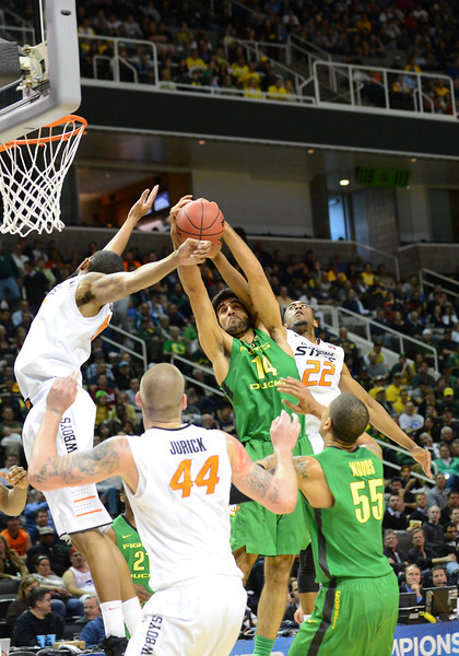 March 21, 2013: Oregon Ducks forward Arsalan Kazemi (14) and Oklahoma State Cowboys guard Markel Brown (22) battle for a rebound during a game between the Oregon Ducks and the Oklahoma State Cowboys in the second round of the NCAA Division I Men's Basketball Championship at HP Pavilion in San Jose, California.