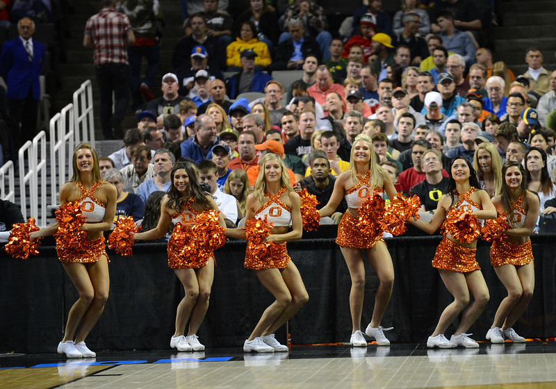 March 21, 2013: Oklahoma State Cowboys cheerleaders perform during a game between the Oregon Ducks and the Oklahoma State Cowboys in the second round of the NCAA Division I Men's Basketball Championship at HP Pavilion in San Jose, California.
