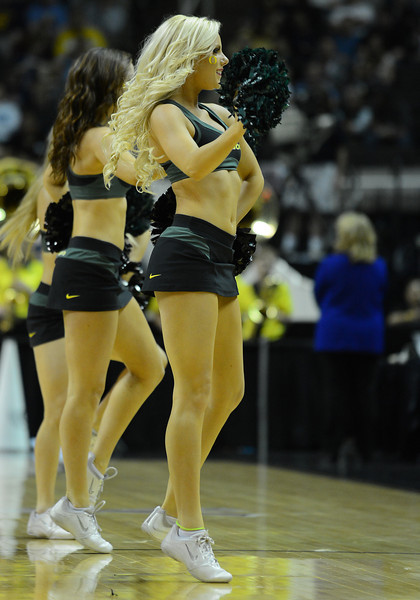 March 23, 2013: Oregon Ducks cheerleaders perform in a timeout during a game between the Oregon Ducks and the Saint Louis Billikens in the third round of the NCAA Division I Men's Basketball Championship at HP Pavilion in San Jose, California.