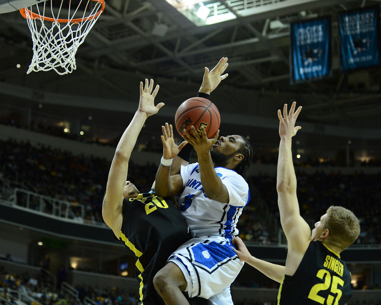 March 23, 2013: Saint Louis Billikens guard Jordair Jett (5) puts up a contested shot during a game between the Oregon Ducks and the Saint Louis Billikens in the third round of the NCAA Division I Men's Basketball Championship at HP Pavilion in San Jose, California.