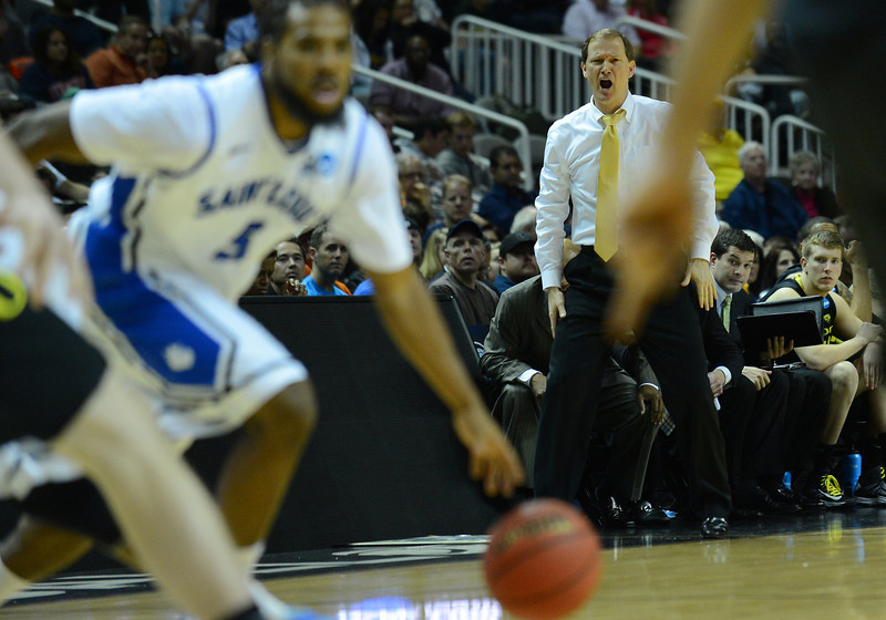 March 23, 2013: Oregon Ducks head coach Dana Altman yells instructions to his team during a game between the Oregon Ducks and the Saint Louis Billikens in the third round of the NCAA Division I Men's Basketball Championship at HP Pavilion in San Jose, California.