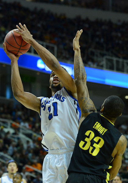 March 23, 2013: Saint Louis Billikens forward Dwayne Evans (21) shoots around Oregon Ducks forward Carlos Emory (33) during a game between the Oregon Ducks and the Saint Louis Billikens in the third round of the NCAA Division I Men's Basketball Championship at HP Pavilion in San Jose, California.