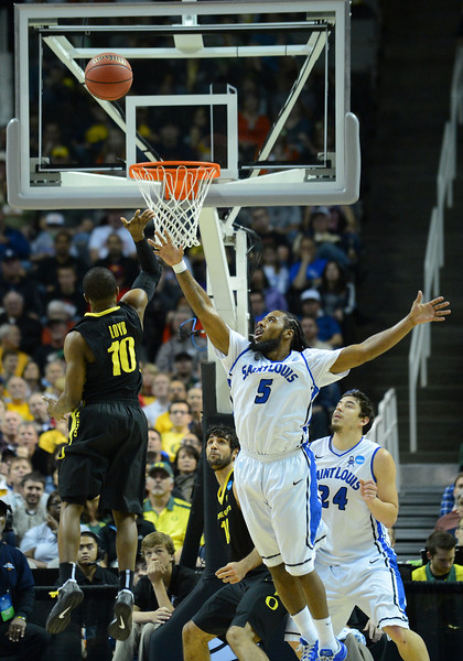 March 23, 2013: Oregon Ducks guard Johnathan Loyd (10) floats a shot over Saint Louis Billikens guard Jordair Jett (5) during a game between the Oregon Ducks and the Saint Louis Billikens in the third round of the NCAA Division I Men's Basketball Championship at HP Pavilion in San Jose, California.