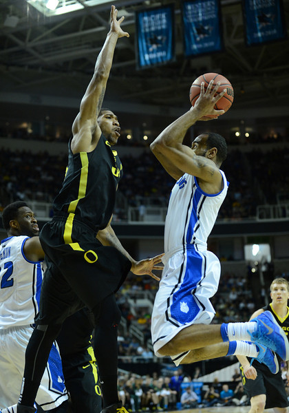 March 23, 2013: Oregon Ducks forward Carlos Emory (33) contests a shot by Saint Louis Billikens guard Kwamain Mitchell (3) during a game between the Oregon Ducks and the Saint Louis Billikens in the third round of the NCAA Division I Men's Basketball Championship at HP Pavilion in San Jose, California.
