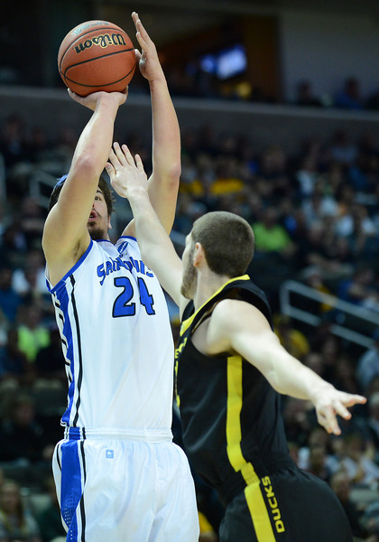 March 23, 2013: Saint Louis Billikens forward Cody Ellis (24) puts up a shot during a game between the Oregon Ducks and the Saint Louis Billikens in the third round of the NCAA Division I Men's Basketball Championship at HP Pavilion in San Jose, California.