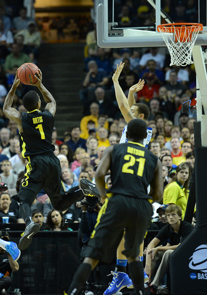 March 23, 2013: Oregon Ducks guard Dominic Artis (1) puts up a shot during a game between the Oregon Ducks and the Saint Louis Billikens in the third round of the NCAA Division I Men's Basketball Championship at HP Pavilion in San Jose, California.