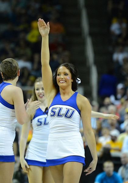 March 23, 2013: A Saint Louis Billikens cheerleader performs in a timeout during a game between the Oregon Ducks and the Saint Louis Billikens in the third round of the NCAA Division I Men's Basketball Championship at HP Pavilion in San Jose, California.