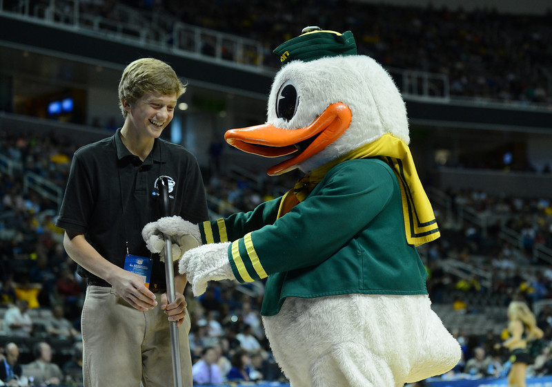 March 23, 2013: The Oregon Ducks mascot plays with one of the ball boys  in a timeout during a game between the Oregon Ducks and the Saint Louis Billikens in the third round of the NCAA Division I Men's Basketball Championship at HP Pavilion in San Jose, California.