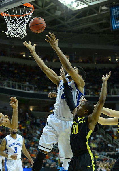 March 23, 2013: Saint Louis Billikens forward Dwayne Evans (21) battles for a rebound during a game between the Oregon Ducks and the Saint Louis Billikens in the third round of the NCAA Division I Men's Basketball Championship at HP Pavilion in San Jose, California.