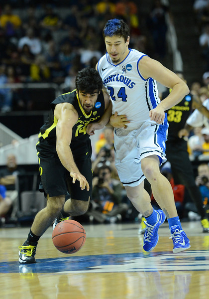 March 23, 2013: Oregon Ducks forward Arsalan Kazemi (14) and Saint Louis Billikens forward Cody Ellis (24) battle for a loose ball during a game between the Oregon Ducks and the Saint Louis Billikens in the third round of the NCAA Division I Men's Basketball Championship at HP Pavilion in San Jose, California.