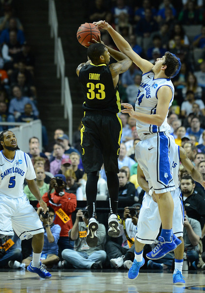 March 23, 2013: Saint Louis Billikens forward Cody Ellis (24) blocks a shot by Oregon Ducks forward Carlos Emory (33) during a game between the Oregon Ducks and the Saint Louis Billikens in the third round of the NCAA Division I Men's Basketball Championship at HP Pavilion in San Jose, California.