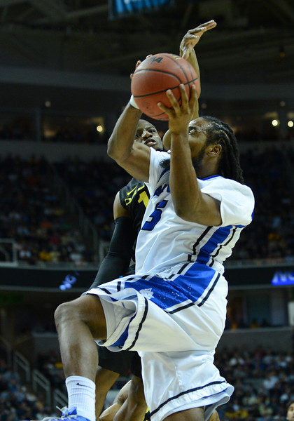March 23, 2013: Oregon Ducks guard Johnathan Loyd (10) tries to block a shot attempt by Saint Louis Billikens guard Jordair Jett (5) during a game between the Oregon Ducks and the Saint Louis Billikens in the third round of the NCAA Division I Men's Basketball Championship at HP Pavilion in San Jose, California.