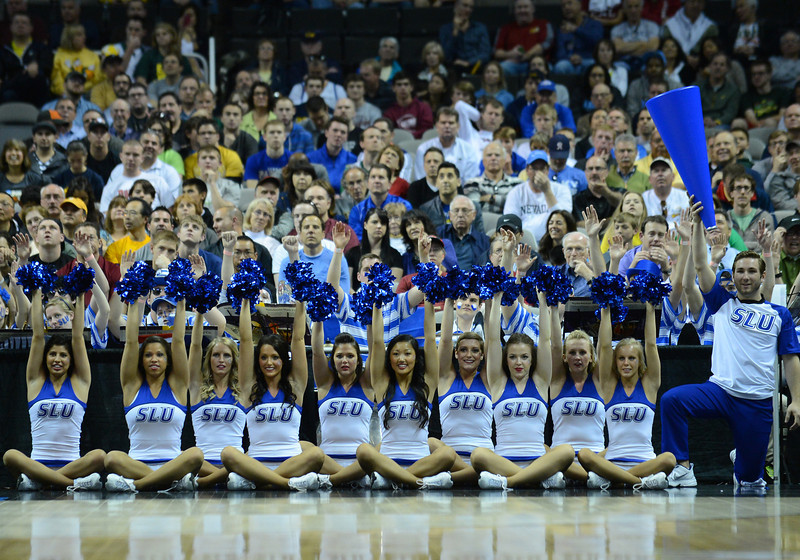 March 23, 2013: Saint Louis Billikens cheerleaders raise their poms while a Saint Louis Billikens player shoots a free throw during a game between the Oregon Ducks and the Saint Louis Billikens in the third round of the NCAA Division I Men's Basketball Championship at HP Pavilion in San Jose, California.