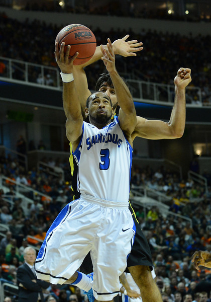 March 23, 2013: Saint Louis Billikens guard Kwamain Mitchell (3) goes strong to the basket during a game between the Oregon Ducks and the Saint Louis Billikens in the third round of the NCAA Division I Men's Basketball Championship at HP Pavilion in San Jose, California.