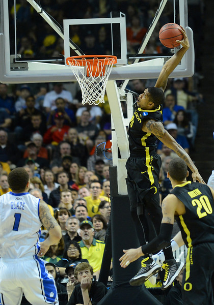 March 23, 2013: Oregon Ducks forward Carlos Emory (33) attempts a dunk during a game between the Oregon Ducks and the Saint Louis Billikens in the third round of the NCAA Division I Men's Basketball Championship at HP Pavilion in San Jose, California.