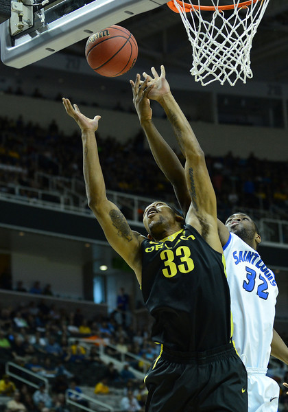 March 23, 2013: Oregon Ducks forward Carlos Emory (33) and Saint Louis Billikens forward Cory Remekun (32) battle for a rebound during a game between the Oregon Ducks and the Saint Louis Billikens in the third round of the NCAA Division I Men's Basketball Championship at HP Pavilion in San Jose, California.
