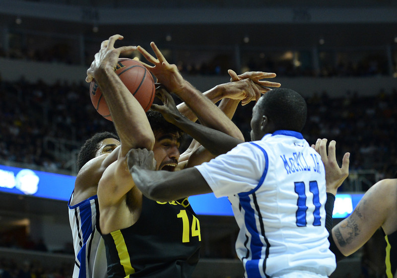 March 23, 2013: Oregon Ducks forward Arsalan Kazemi (14) battles for a rebound during a game between the Oregon Ducks and the Saint Louis Billikens in the third round of the NCAA Division I Men's Basketball Championship at HP Pavilion in San Jose, California.