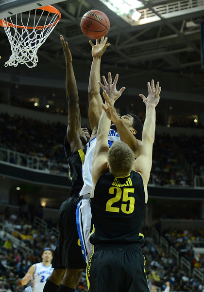 March 23, 2013: Saint Louis Billikens forward Dwayne Evans (21) puts up a contested shot during a game between the Oregon Ducks and the Saint Louis Billikens in the third round of the NCAA Division I Men's Basketball Championship at HP Pavilion in San Jose, California.