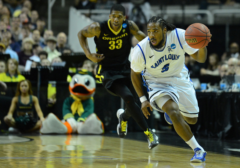 March 23, 2013: Saint Louis Billikens guard Jordair Jett (5) brings the ball up the court during a game between the Oregon Ducks and the Saint Louis Billikens in the third round of the NCAA Division I Men's Basketball Championship at HP Pavilion in San Jose, California.