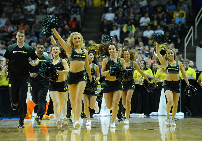 March 23, 2013: Oregon Ducks cheerleaders take the court during a game between the Oregon Ducks and the Saint Louis Billikens in the third round of the NCAA Division I Men's Basketball Championship at HP Pavilion in San Jose, California.
