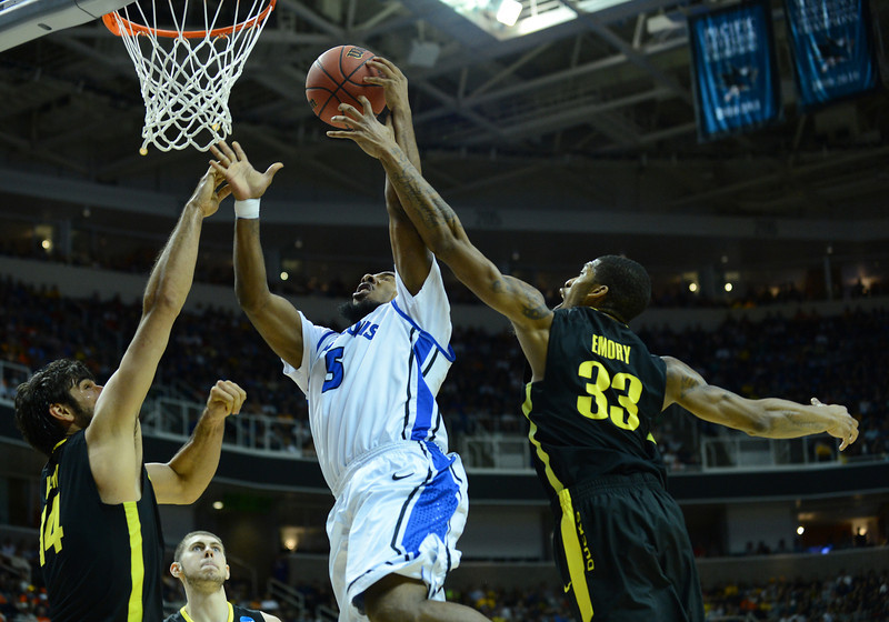 March 23, 2013: Saint Louis Billikens guard Jordair Jett (5) is fouled driving to the basket during a game between the Oregon Ducks and the Saint Louis Billikens in the third round of the NCAA Division I Men's Basketball Championship at HP Pavilion in San Jose, California.