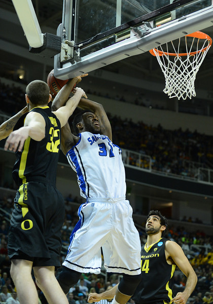 March 23, 2013: Saint Louis Billikens forward Cory Remekun (32) is fouled by Oregon Ducks forward Ben Carter (32) during a game between the Oregon Ducks and the Saint Louis Billikens in the third round of the NCAA Division I Men's Basketball Championship at HP Pavilion in San Jose, California.