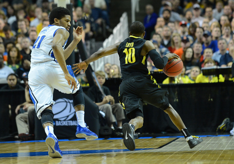 March 23, 2013: Saint Louis Billikens forward Dwayne Evans (21) tries to guard Oregon Ducks guard Johnathan Loyd (10) during a game between the Oregon Ducks and the Saint Louis Billikens in the third round of the NCAA Division I Men's Basketball Championship at HP Pavilion in San Jose, California.