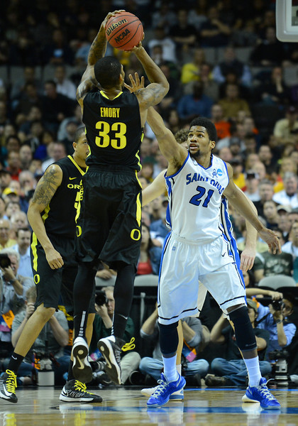 March 23, 2013: Oregon Ducks forward Carlos Emory (33) shoots over the defense of Saint Louis Billikens forward Dwayne Evans (21) during a game between the Oregon Ducks and the Saint Louis Billikens in the third round of the NCAA Division I Men's Basketball Championship at HP Pavilion in San Jose, California.