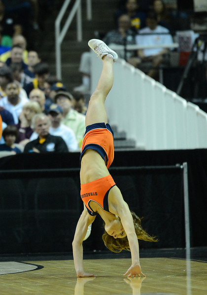 March 23, 2013: A Syracuse Orange cheerleader performs in a timeout during a game between the Syracuse Orange and the California Golden Bears in the third round of the NCAA Division I Men's Basketball Championship at HP Pavilion in San Jose, California.