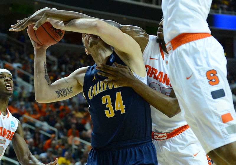 March 23, 2013: California Golden Bears forward Robert Thurman (34) is fouled going up for a shot during a game between the Syracuse Orange and the California Golden Bears in the third round of the NCAA Division I Men's Basketball Championship at HP Pavilion in San Jose, California.