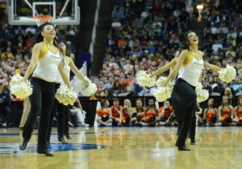 March 23, 2013: California Golden Bears cheerleaders perform in a timeout during a game between the Syracuse Orange and the California Golden Bears in the third round of the NCAA Division I Men's Basketball Championship at HP Pavilion in San Jose, California.