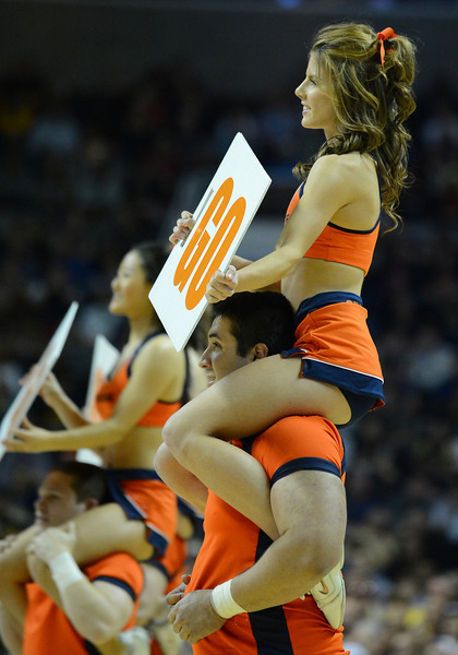 March 23, 2013: Syracuse Orange cheerleaders perform in a timeout during a game between the Syracuse Orange and the California Golden Bears in the third round of the NCAA Division I Men's Basketball Championship at HP Pavilion in San Jose, California.