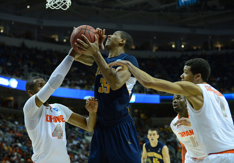 March 23, 2013: California Golden Bears forward Richard Solomon (35) goes strong to the basket during a game between the Syracuse Orange and the California Golden Bears in the third round of the NCAA Division I Men's Basketball Championship at HP Pavilion in San Jose, California.