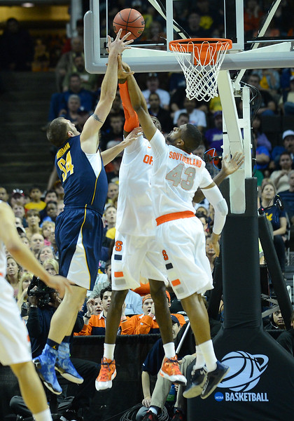 March 23, 2013: California Golden Bears forward Robert Thurman (34) puts up a shot against the Syracuse Orange defense during a game between the Syracuse Orange and the California Golden Bears in the third round of the NCAA Division I Men's Basketball Championship at HP Pavilion in San Jose, California.