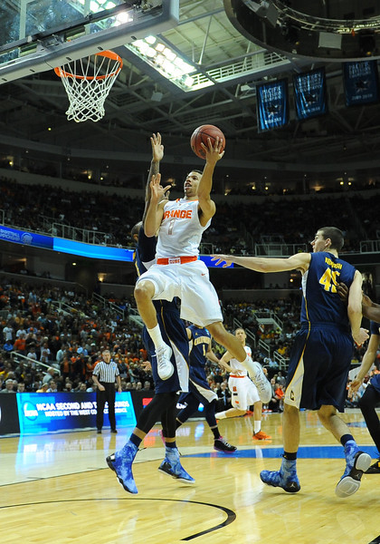 March 23, 2013: Syracuse Orange guard Michael Carter-Williams (1) drives in for a layup during a game between the Syracuse Orange and the California Golden Bears in the third round of the NCAA Division I Men's Basketball Championship at HP Pavilion in San Jose, California.