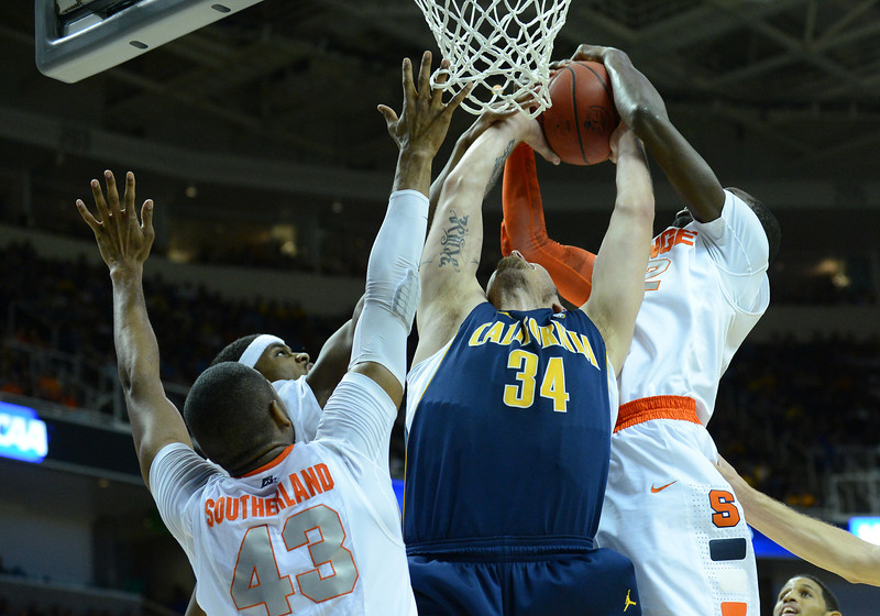 March 23, 2013: Syracuse Orange center Baye Keita (12) blocks the shot of California Golden Bears forward Robert Thurman (34) during a game between the Syracuse Orange and the California Golden Bears in the third round of the NCAA Division I Men's Basketball Championship at HP Pavilion in San Jose, California.