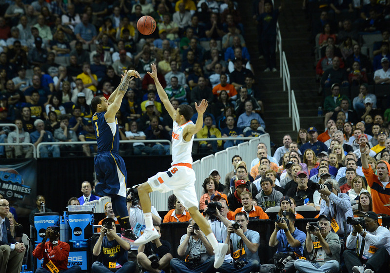 March 23, 2013: California Golden Bears guard Justin Cobbs (1) takes a shot over the defense of Syracuse Orange guard Michael Carter-Williams (1) during a game between the Syracuse Orange and the California Golden Bears in the third round of the NCAA Division I Men's Basketball Championship at HP Pavilion in San Jose, California.
